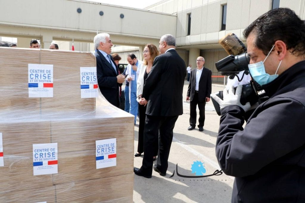 Lebanese officials receiving medical equipment sent by France