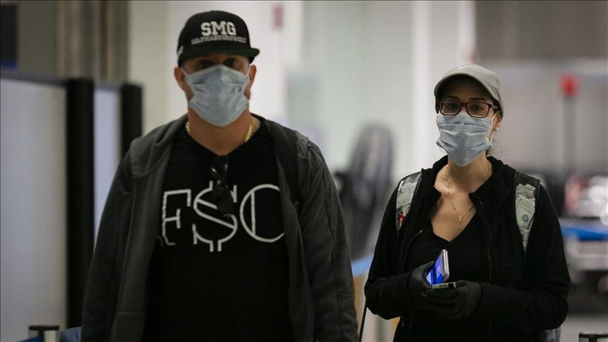 Passengers wearing face masks during coronavirus pandemic