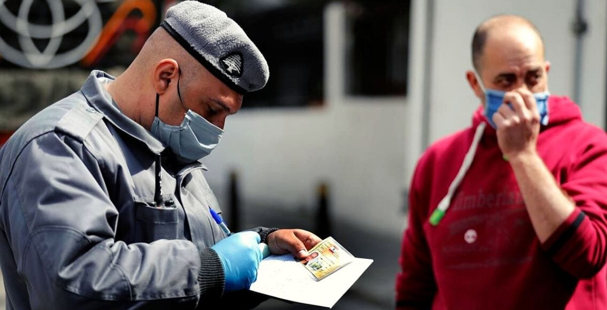 Lebanese ISF member issuing a ticket to a violator