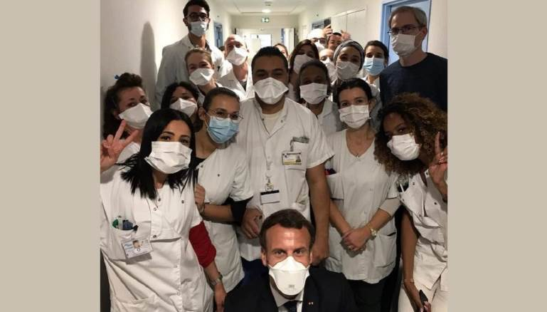 Lebanese doctors posing for a photograph with French President Macron