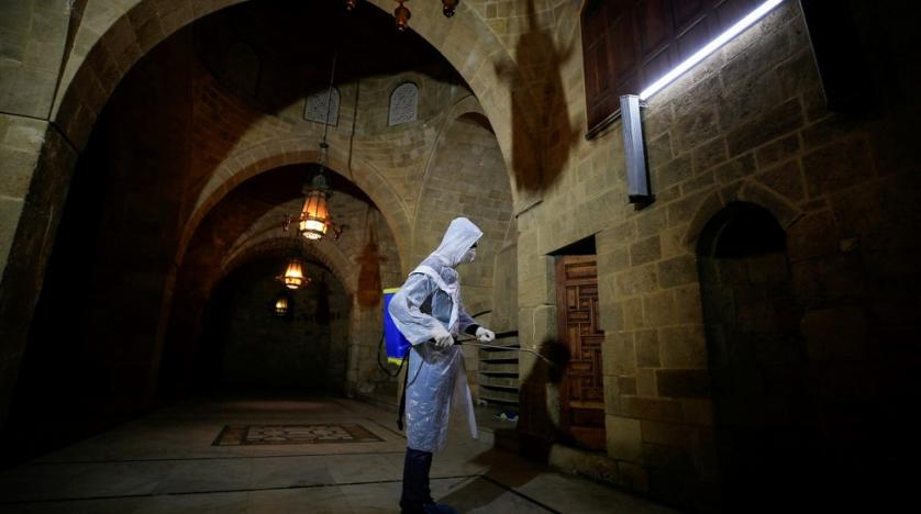 Health worker sanitizes mosque in Lebanon