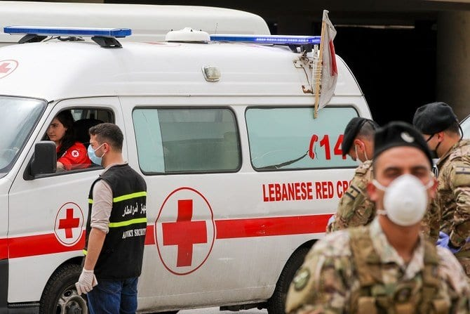 Lebanese Red Cross ambulance and Lebanese Army soldiers