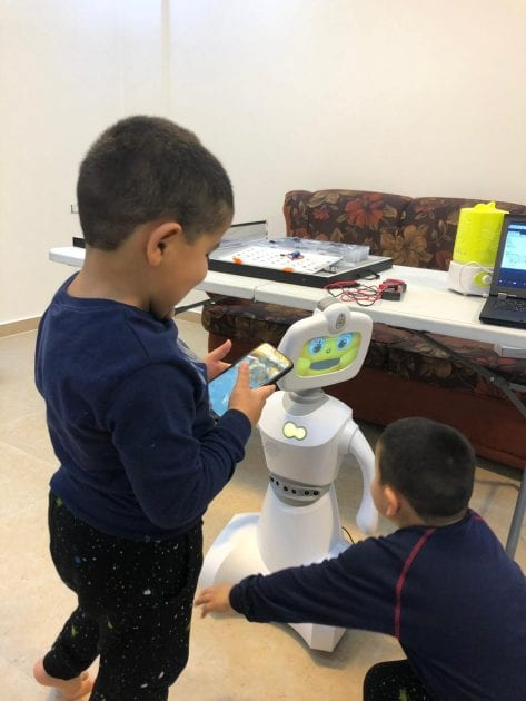 The Lebanese programmer's robot playing with children