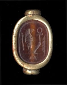 An ancient gold and onyx scarab seal