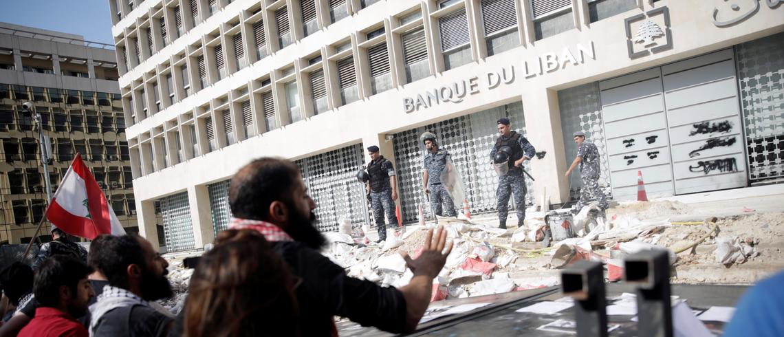 Protesters rally in front of the central bank in Beirut