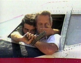 The captain of the hijacked plane was held at gunpoint