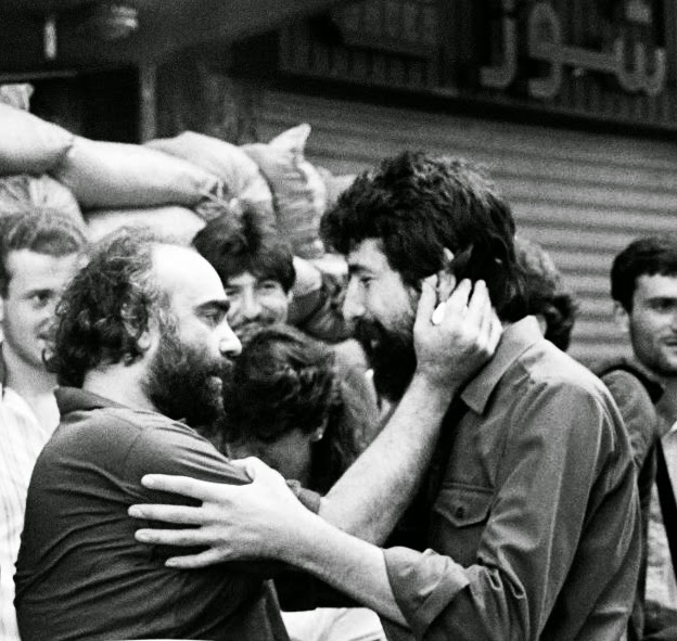 Demis Roussos says goodbye to Akel Hamieh (right), of the Amal militia, after his release