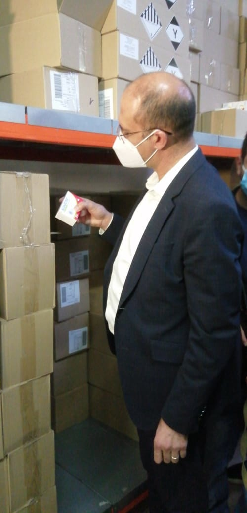 Caretaker Health Minister Hamad Hasan during an inspection of a pharmaceutical warehouse.