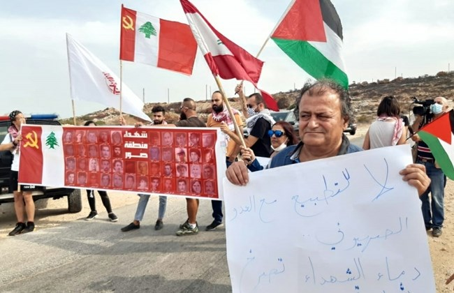 Protesters gather outside the UNIFIL headquarters in Naqoura, condemning Israel's participation in the border demarcation talks they say should have been conducted between Lebanon and Palestine.