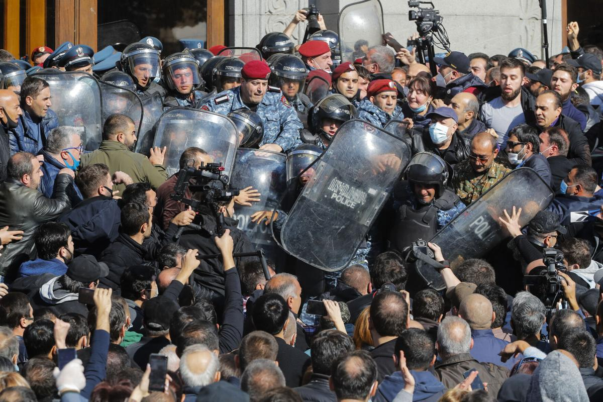 Armenian protesters clash with riot police.