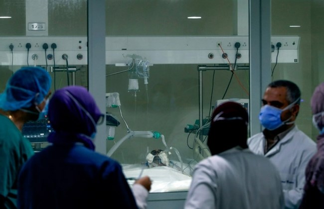 A medical team gathers in an Intensive Care Unit at Rafik Hariri University Hospital.