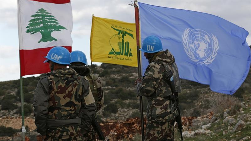 The flags of Lebanon, Hezbollah, and the UN in South Lebanon.