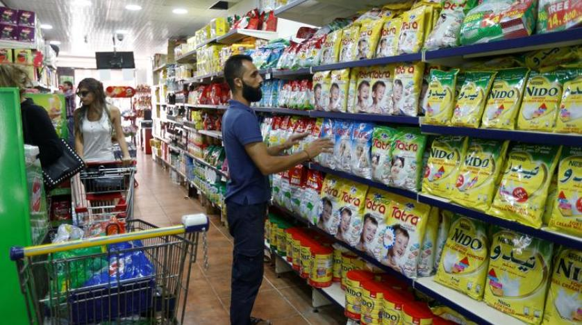 People shopping in a supermarket in Lebanon.