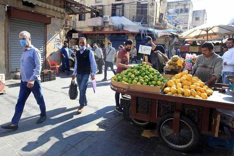 People walk at a souk, as the Lebanese government ordered a national lockdown, to combat a resurgence of the coronavirus disease (COVID-19) outbreak, in Sidon, Lebanon November 16, 2020.