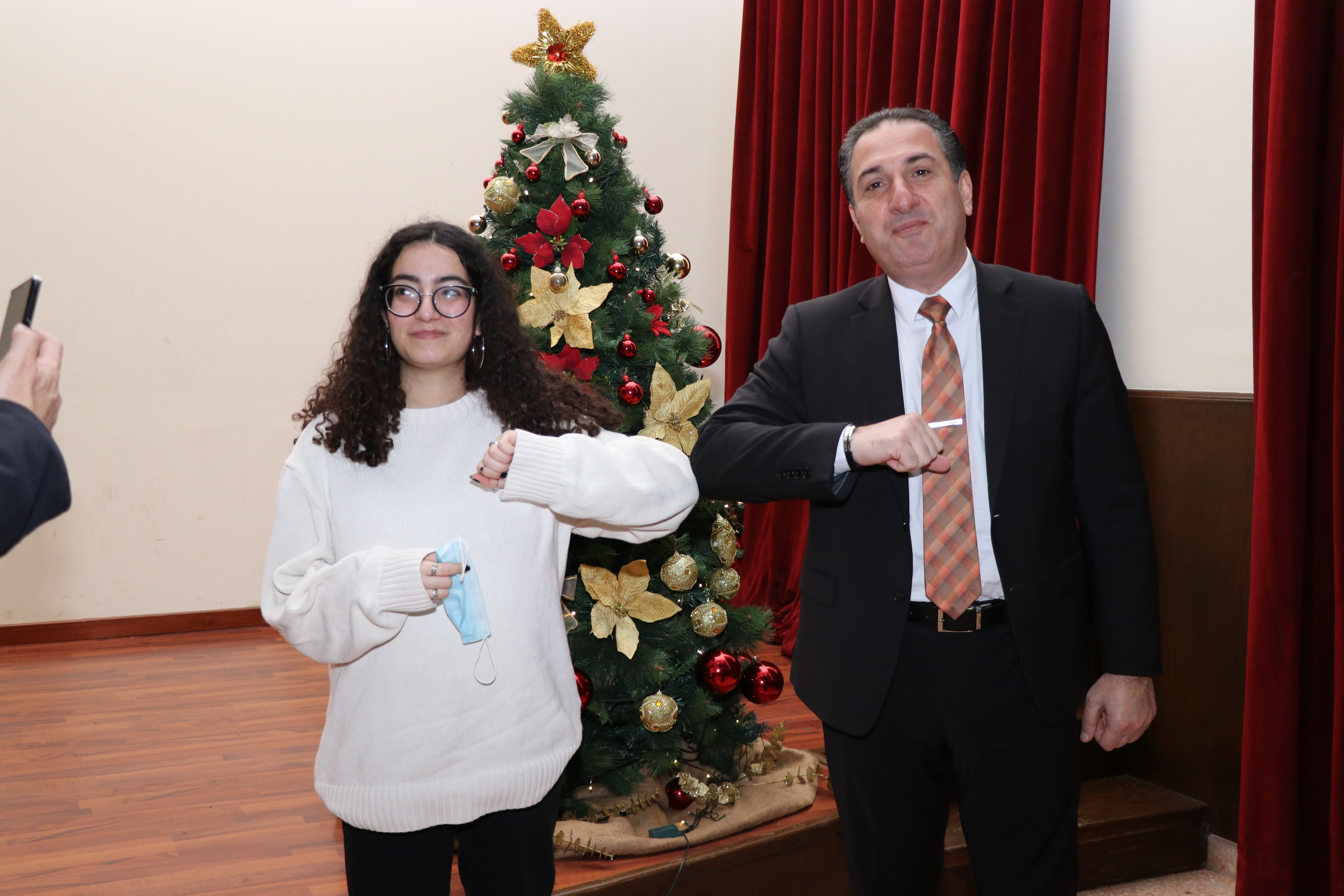 Marina El-Helou posing for a picture with Minister Hawat.