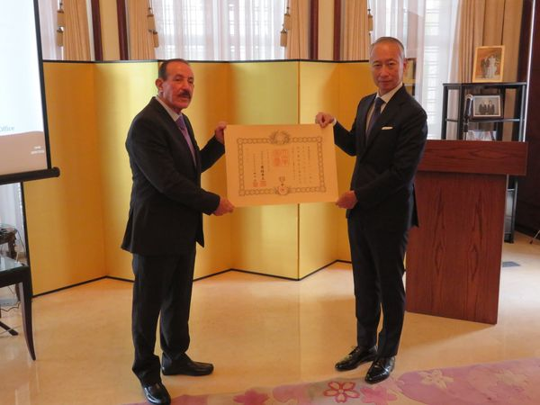 Francois Saade receives the Order of the Rising Sun from Japan's ambassador to Lebanon.