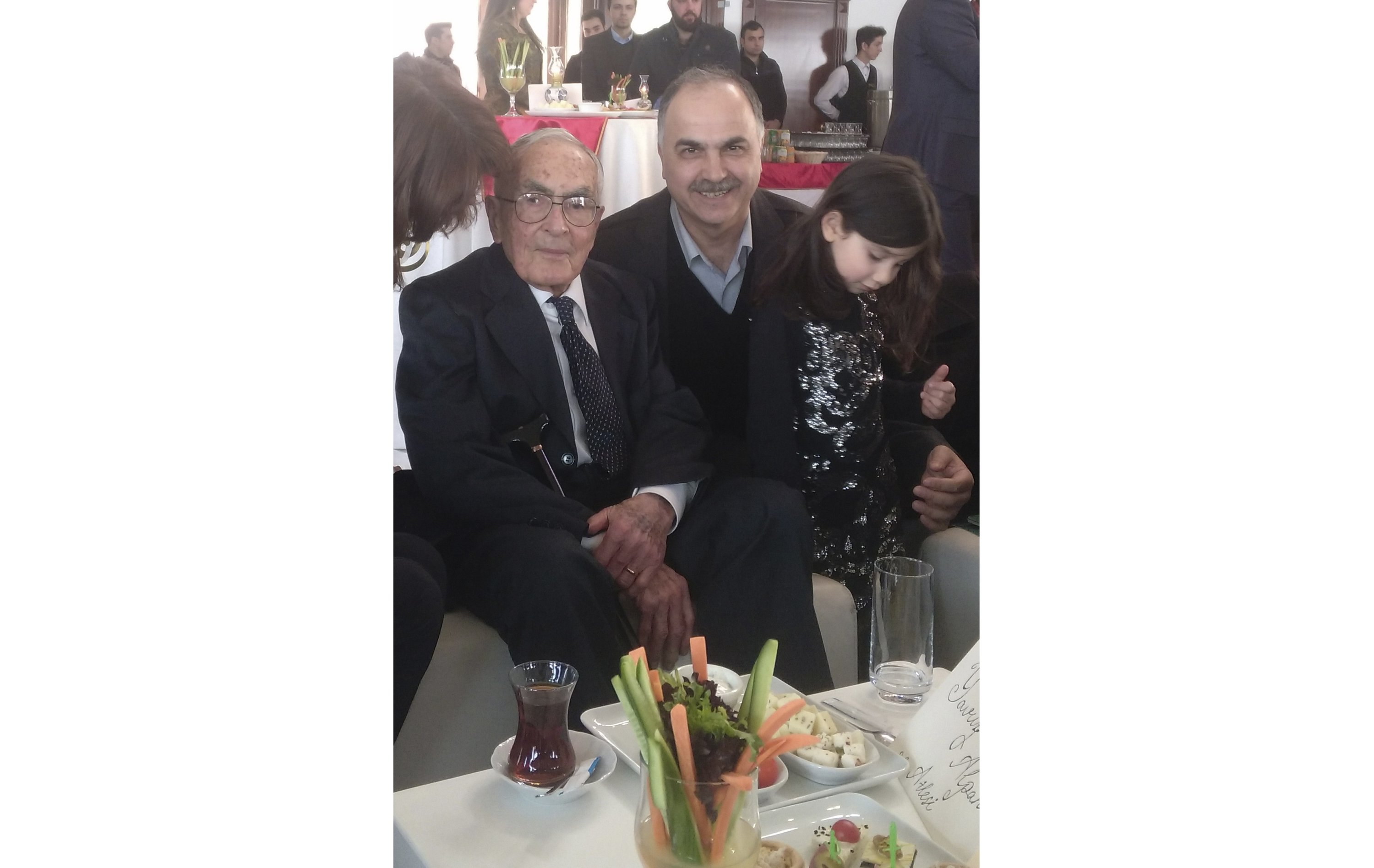 Alpan posing with with his granddaughter and historian Ibrahim Pazan.