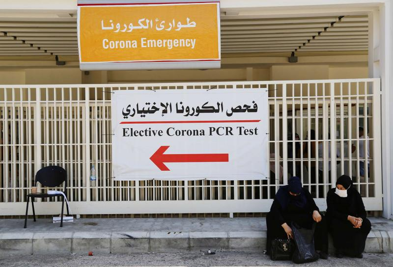 Women wait outside a hospital in Beirut.
