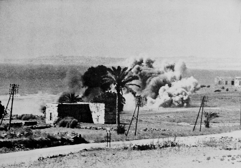 Shell-fire during the Australian advance along the coast road south of Beirut in July 1941.
