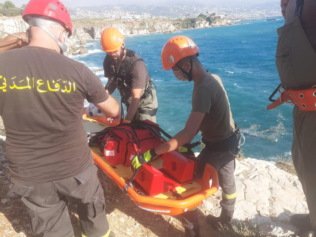 Lebanese Civil Defense members spent nearly two hours working to save a person who got stuck between rocks on Sunday.