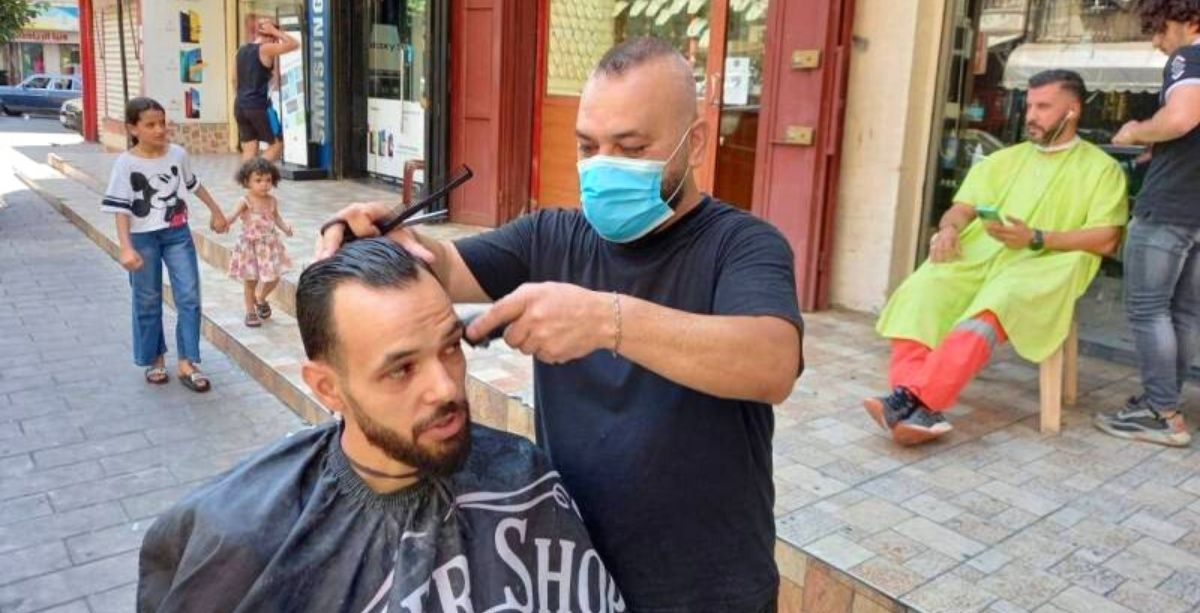 Barbers Are Cutting Hair On The Street Due To Power Cuts In Lebanon