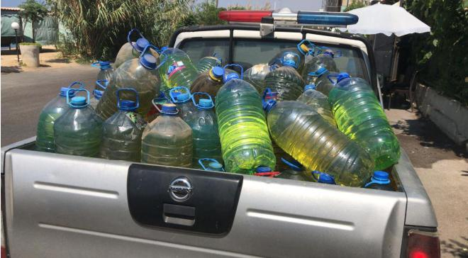 Security forces confiscated dozens of gallons of fuel, prepared for sale on the black market, in a coffee shop in Mount Lebanon.